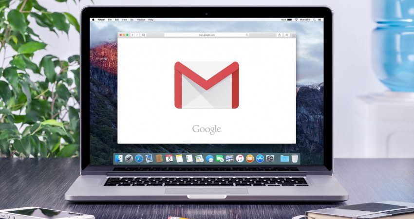 Varna Bulgaria - May 31 2015: Google Gmail logo on the Apple MacBook Pro display that is on office desk workplace. Gmail is a free e-mail service provided by Google.
